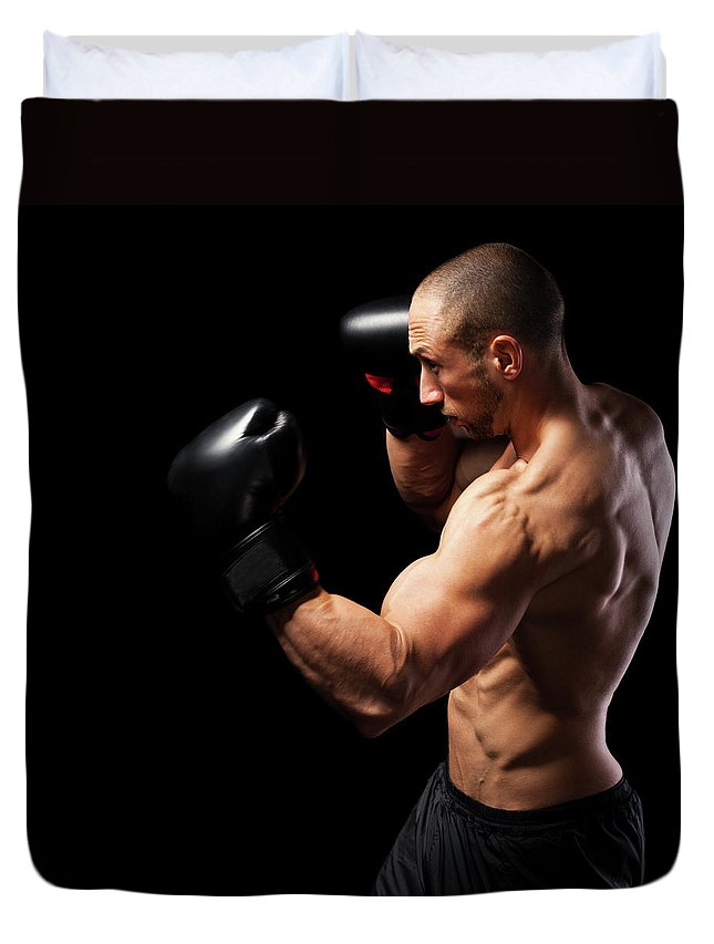 Toughness Duvet Cover featuring the photograph Powerful Punch by Momcilog