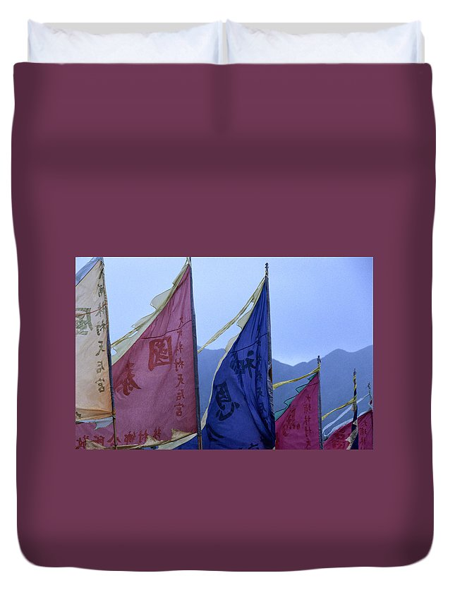 Chinese Culture Duvet Cover featuring the photograph Prayer Flags To The Sea Goddess Blow In by Lonely Planet
