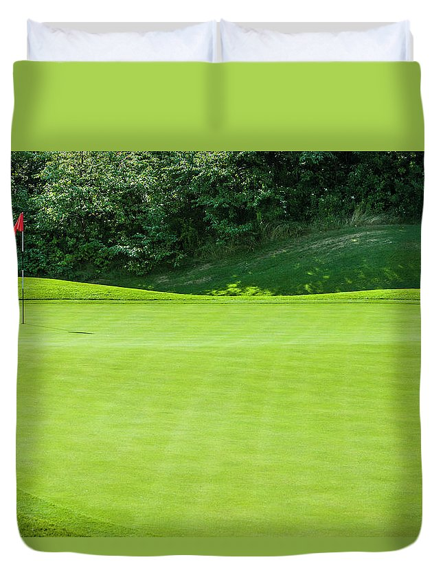 The End Duvet Cover featuring the photograph Putting Green And Flag At A Golf Course by Stuart Dee