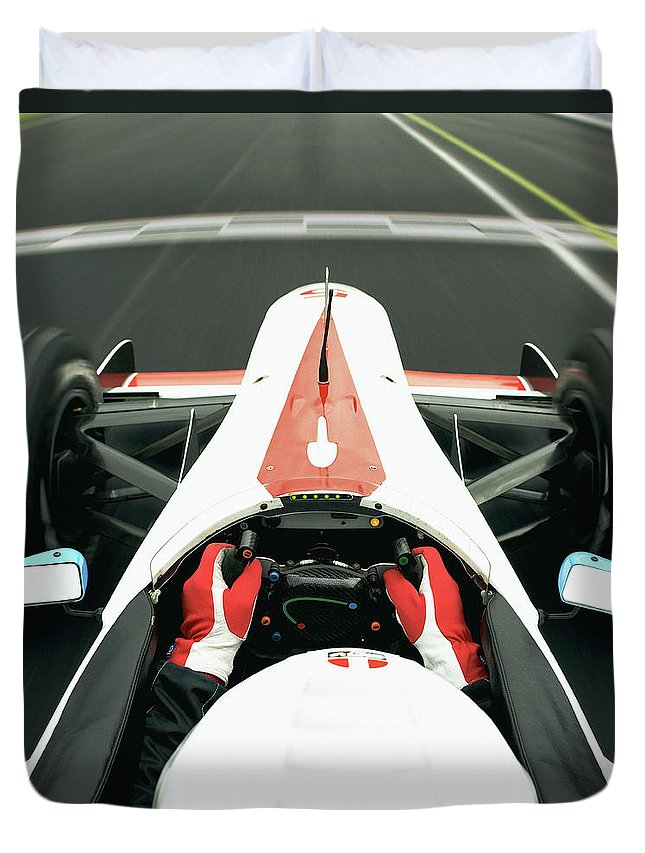 Aerodynamic Duvet Cover featuring the photograph Racing Driver Approaching Finishing by Alan Thornton