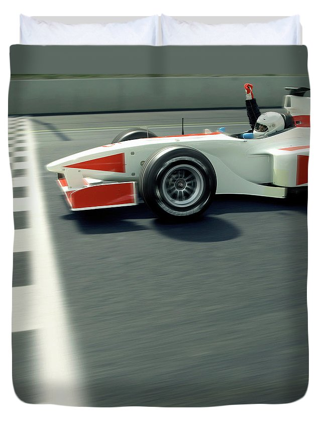 Aerodynamic Duvet Cover featuring the photograph Racing Driver Crossing Finishing Line by Alan Thornton