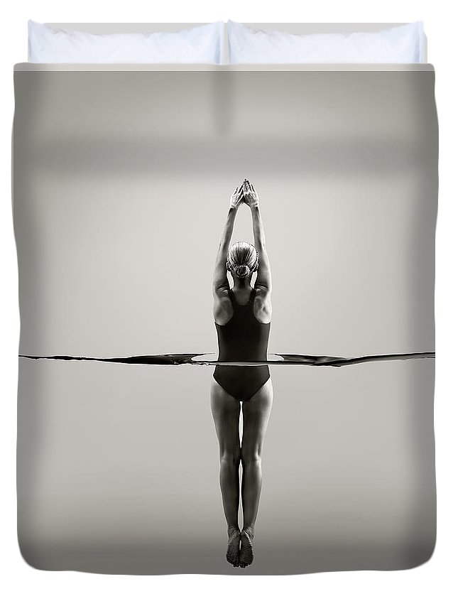 Diving Into Water Duvet Cover featuring the photograph Rear View Of Female Swimmer by Jonathan Knowles