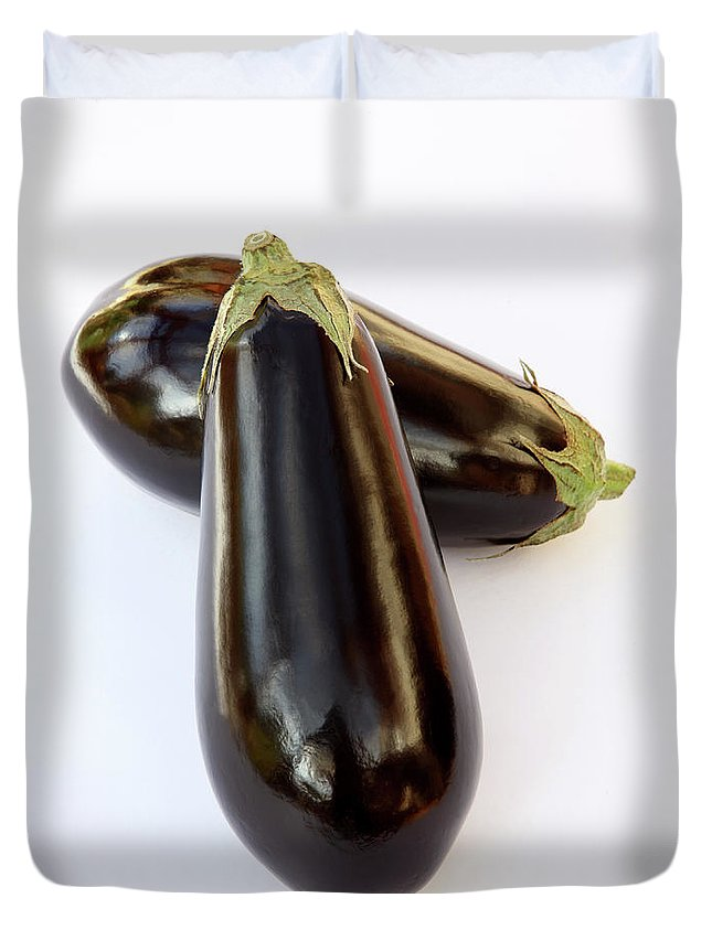 White Background Duvet Cover featuring the photograph Ripe, Organic Aubergines On White by Rosemary Calvert