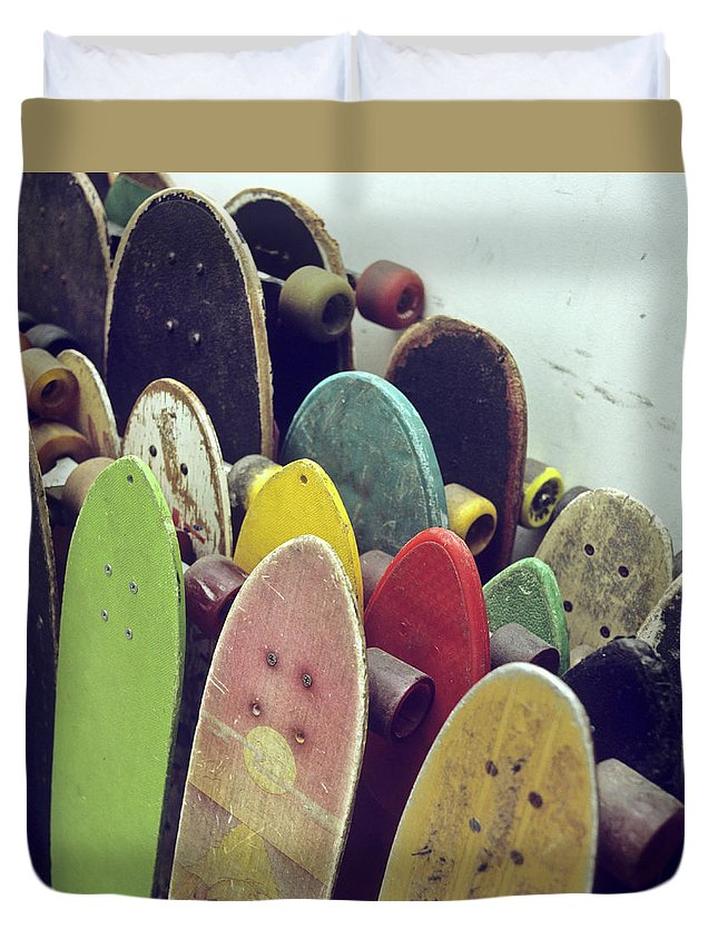 Recreational Pursuit Duvet Cover featuring the photograph Rows Of Used Skateboards Leaning by Fstop Images - Brian Caissie