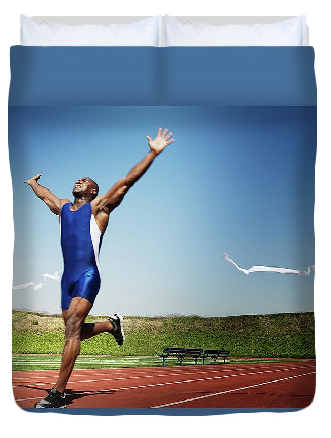 Human Arm Duvet Cover featuring the photograph Runner Crossing Finish Line by Jupiterimages