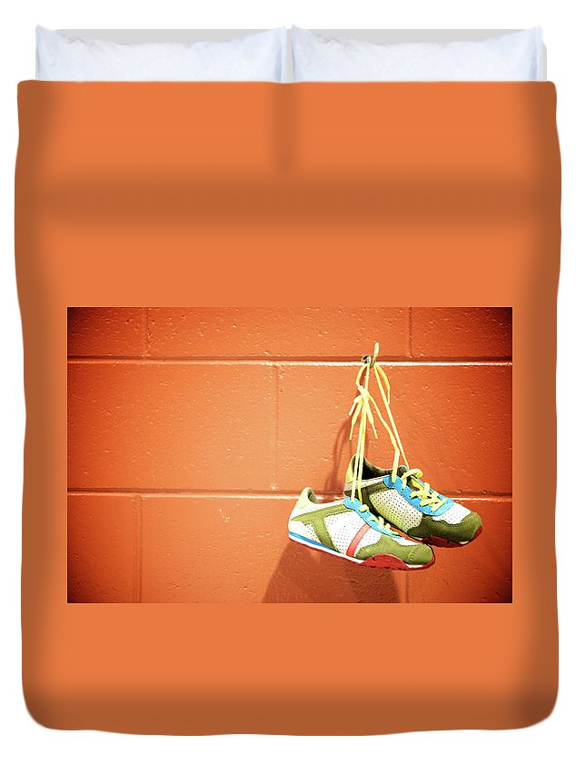 Hanging Duvet Cover featuring the photograph Runnig Shoes Hanging On A Hook by Pascalgenest