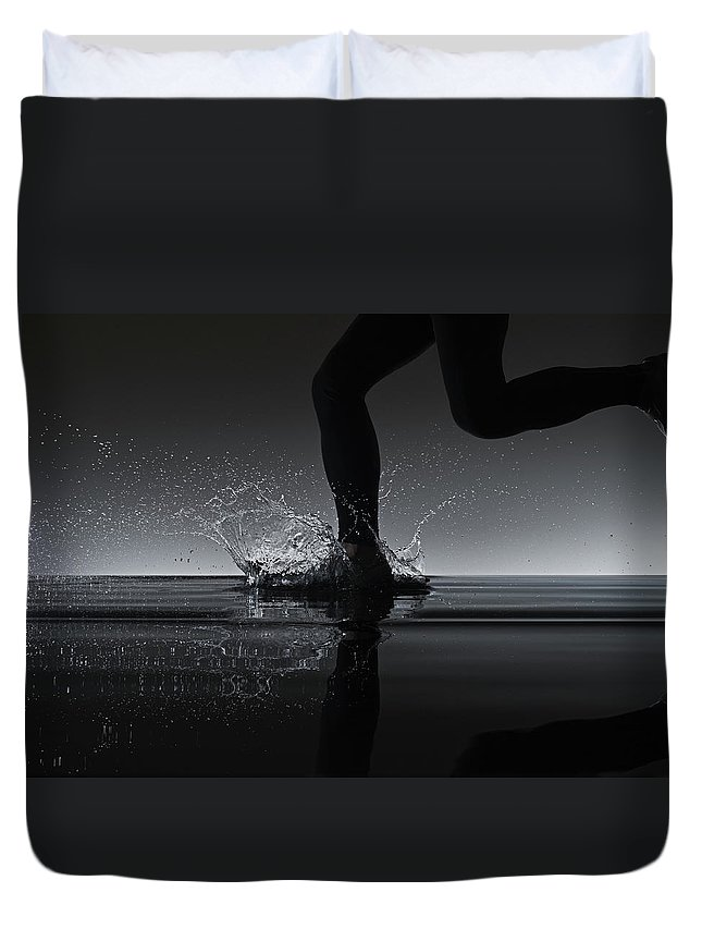 Recreational Pursuit Duvet Cover featuring the photograph Running Through Water by Jonathan Knowles