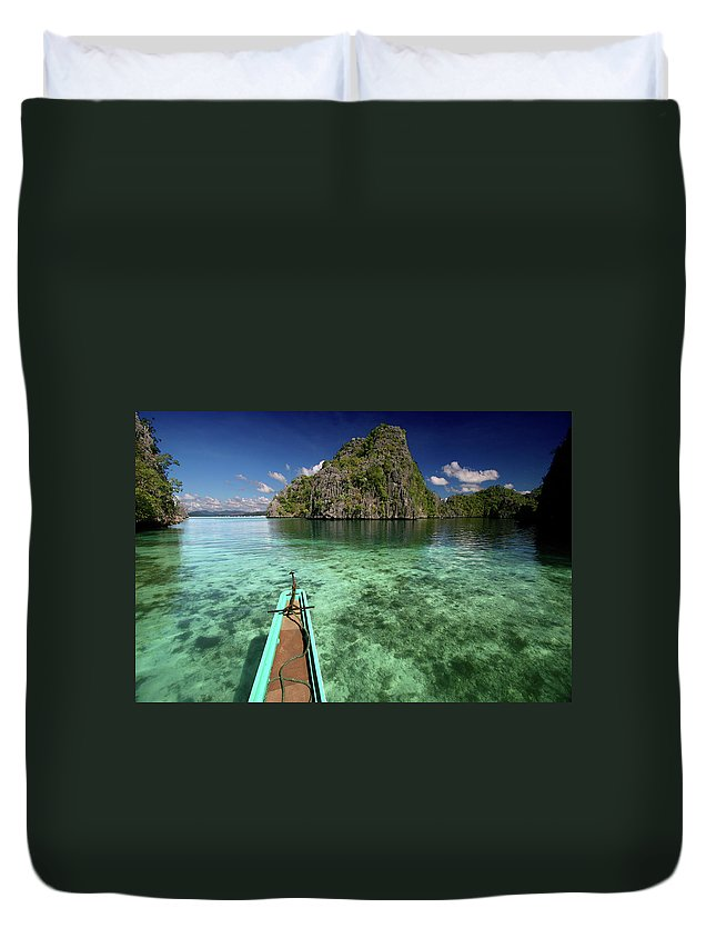 Tranquility Duvet Cover featuring the photograph Sailing Over Coral Coron by Photo ©tan Yilmaz
