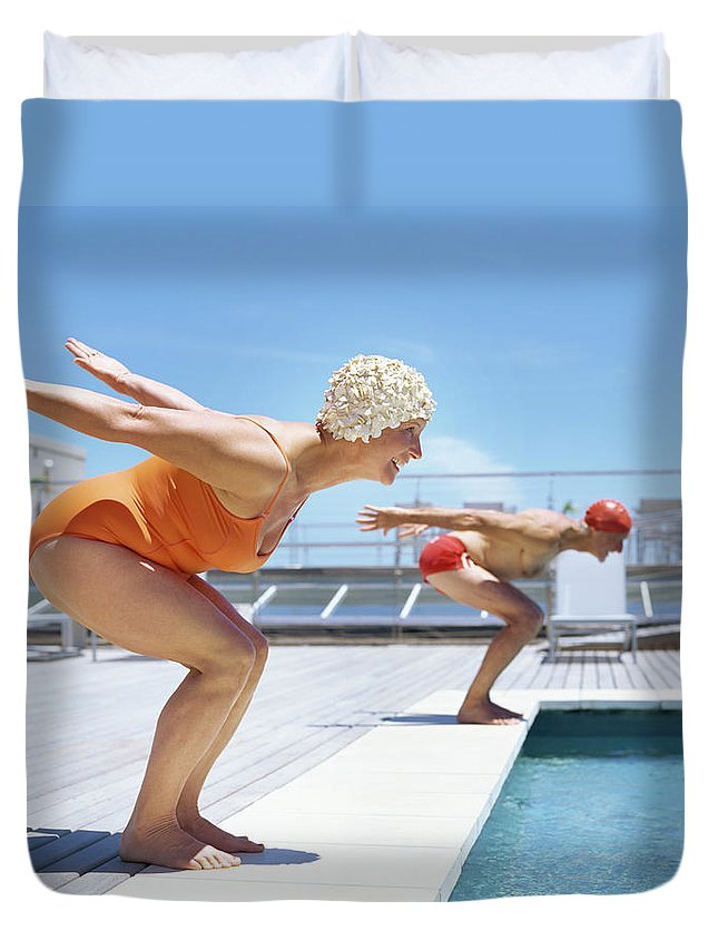 Diving Into Water Duvet Cover featuring the photograph Senior Couple Ready To Dive In To by Stockbyte