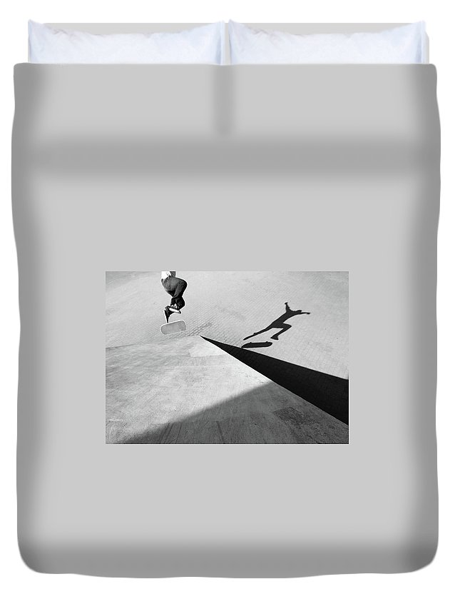 Shadow Duvet Cover featuring the photograph Shadow Of Skateboarder by Mgs