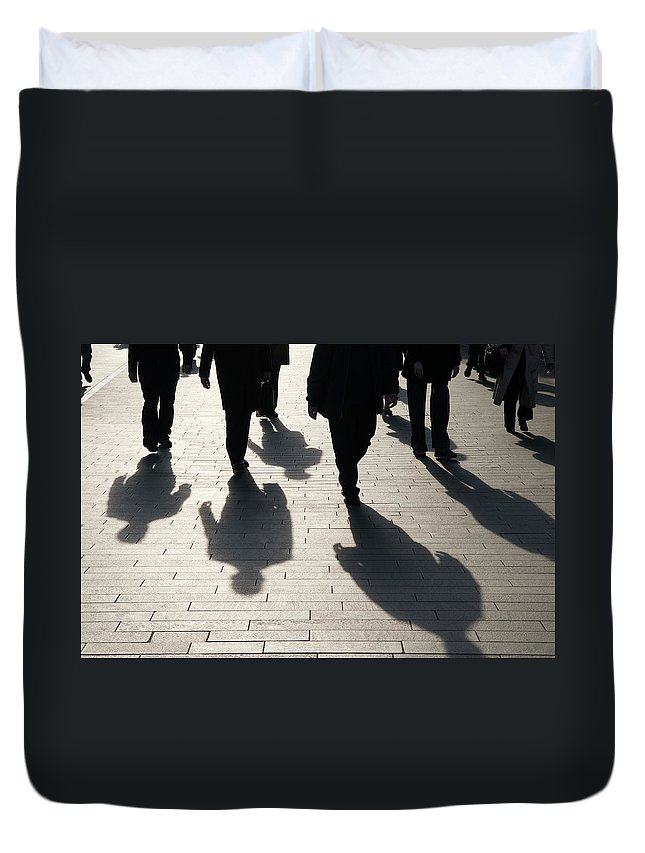 Shadow Duvet Cover featuring the photograph Shadow Team Of Commuters Walking On by Peskymonkey