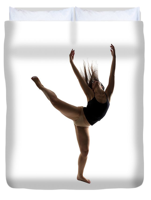 Ballet Dancer Duvet Cover featuring the photograph Silhouette Of A Performing Dancer by Opla