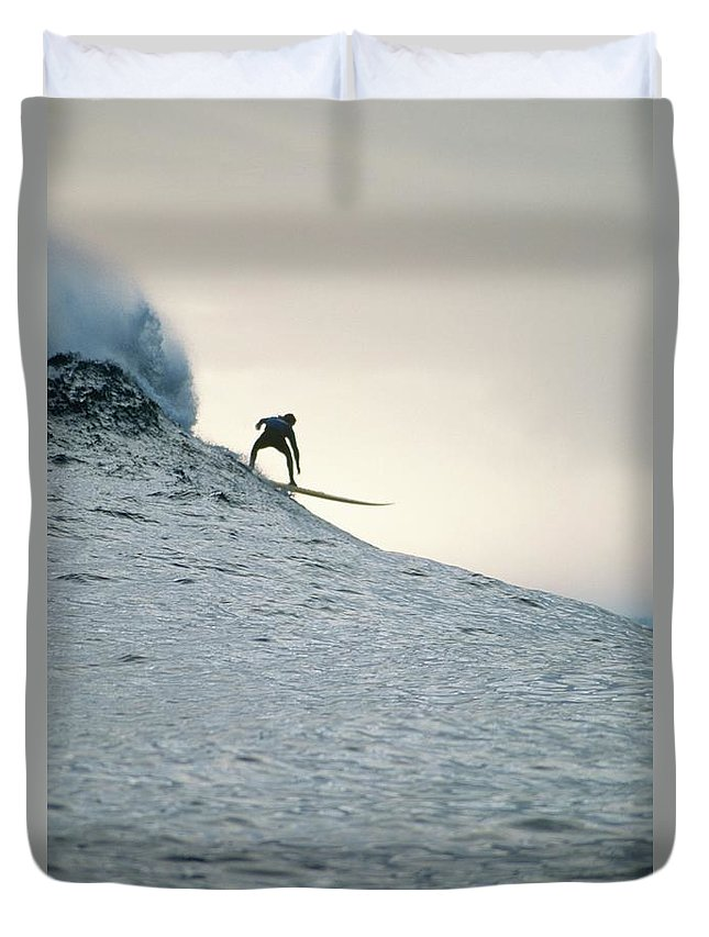 Scenics Duvet Cover featuring the photograph Silhouette Of A Surfer Riding A Wave by Dominic Barnardt