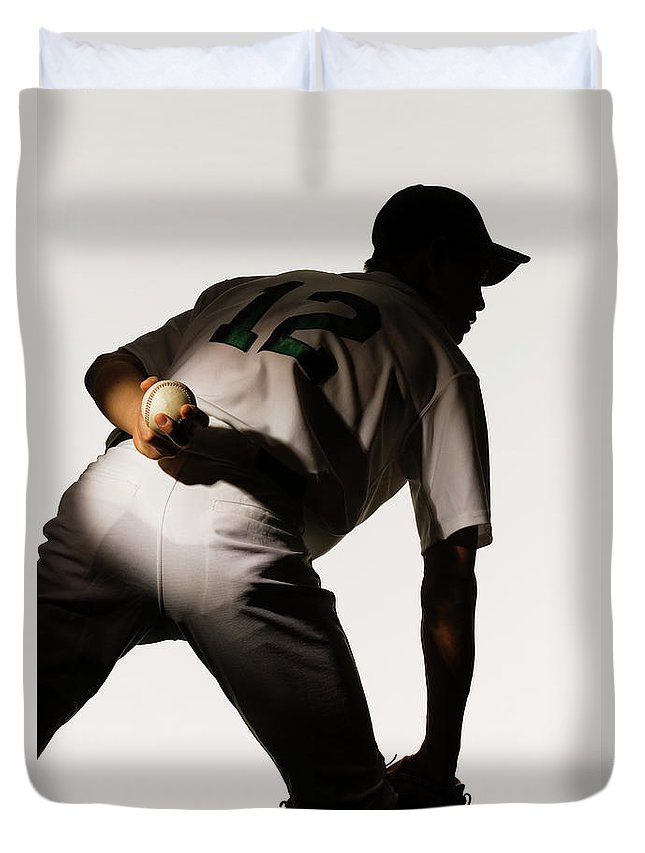 Three Quarter Length Duvet Cover featuring the photograph Silhouette Of Baseball Pitcher Holding by Pm Images