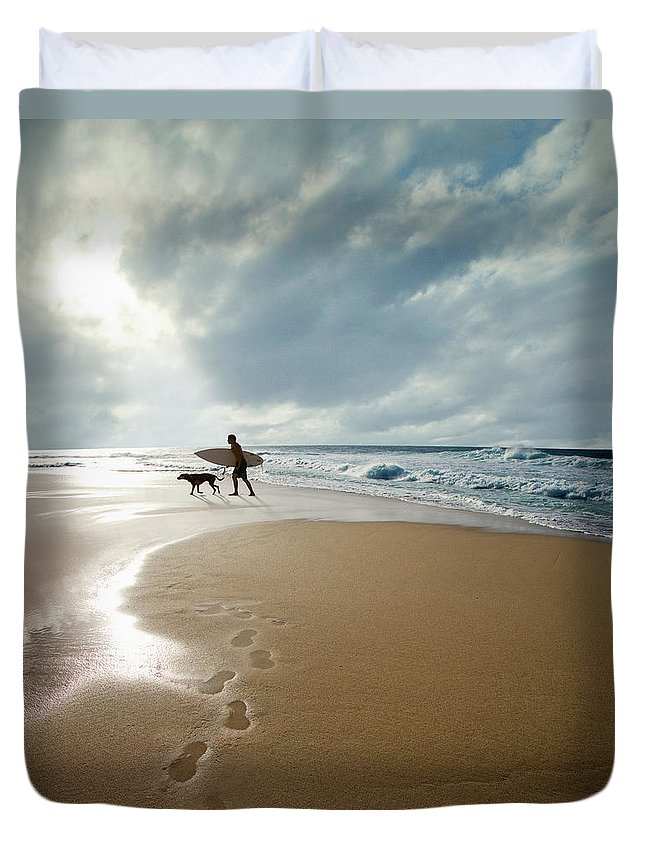 Pets Duvet Cover featuring the photograph Silhouette Of Surfer With Dog Walking by Ed Freeman