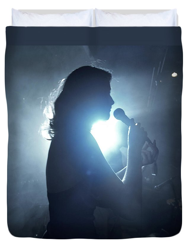 25-29 Years Duvet Cover featuring the photograph Silhouette Of Woman Using Microphone by Frank Herholdt