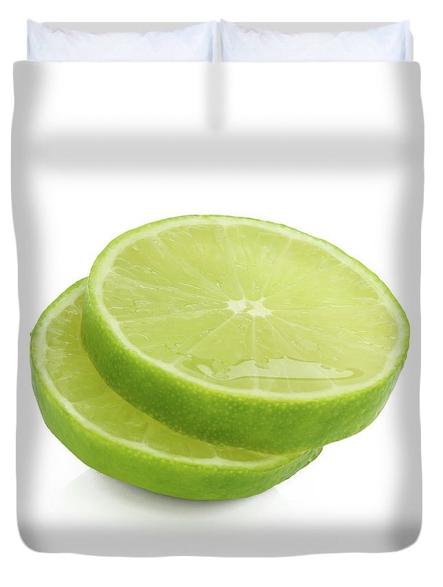 White Background Duvet Cover featuring the photograph Slices Of Fresh, Juicy, Freshly Cut Lime by Rosemary Calvert