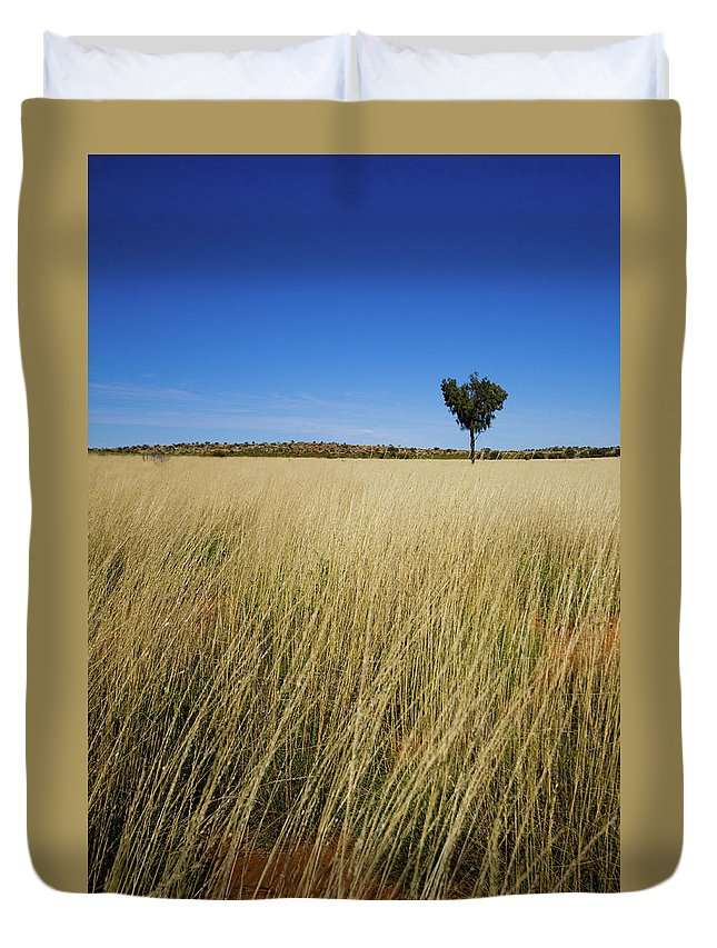 Scenics Duvet Cover featuring the photograph Small Single Tree In Field by Universal Stopping Point Photography
