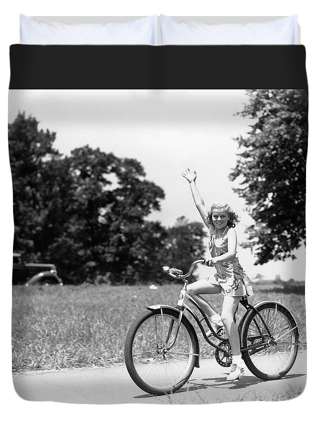 Bicycle Seat Duvet Cover featuring the photograph Smiling Girl Wearing A Jumper Short Set by H. Armstrong Roberts