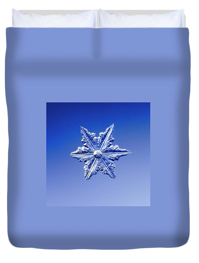 Snow Duvet Cover featuring the photograph Snowflake On Blue Background by Fwwidall