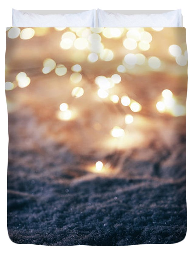 Winter Duvet Cover featuring the photograph Snowy Winter Background With Fairy Lights. by Michal Bednarek