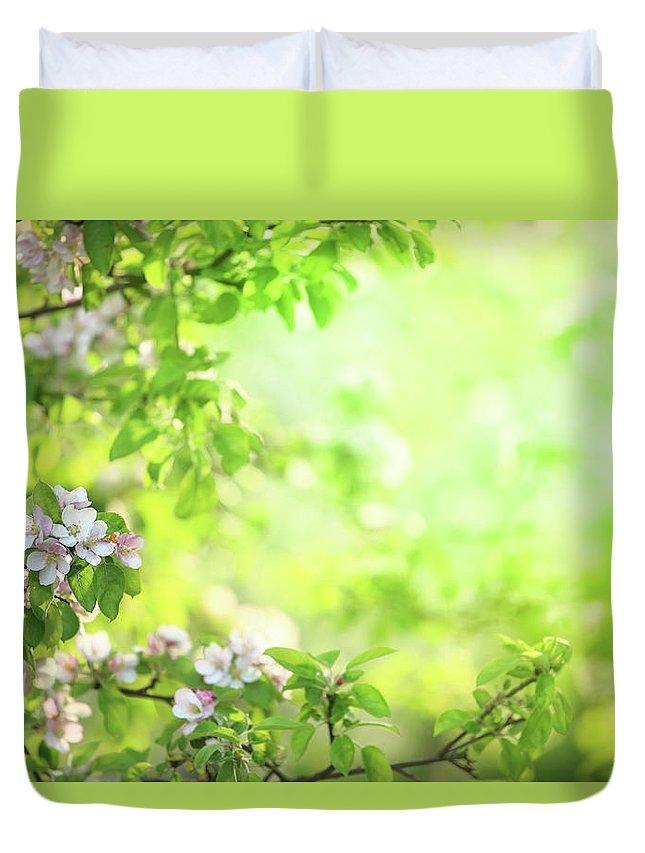 Grass Duvet Cover featuring the photograph Spring Flowers Blooming Orchard - by Konradlew
