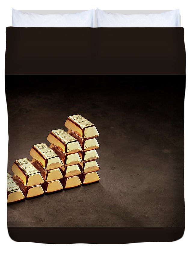 In A Row Duvet Cover featuring the photograph Stepped Stack Of Gold On Dark Surface by Anthony Bradshaw