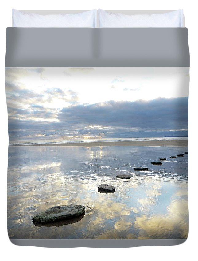 Tranquility Duvet Cover featuring the photograph Stepping Stones Over Water With Sky by Peter Cade