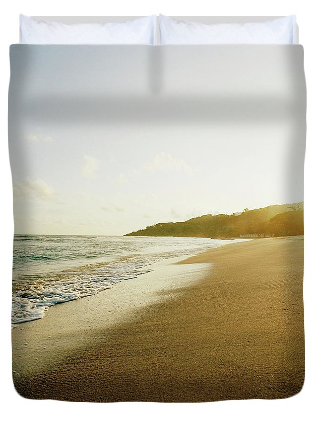 Tranquility Duvet Cover featuring the photograph Sunset At A Beach Of Petit-goave, Haiti by Cultura Exclusive/philip Lee Harvey