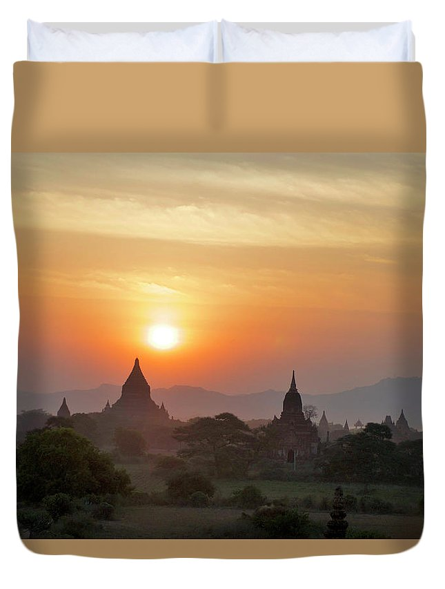 Tranquility Duvet Cover featuring the photograph Sunset From Atop The Shwesandaw Paya by Jim Simmen