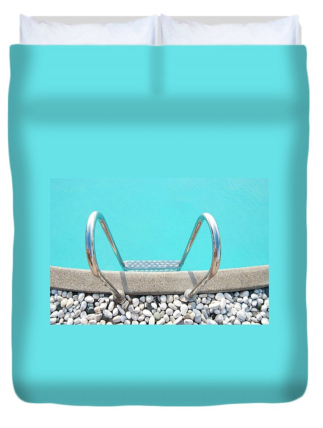 Tranquility Duvet Cover featuring the photograph Swimming Pool With White Pebbles by Lawren