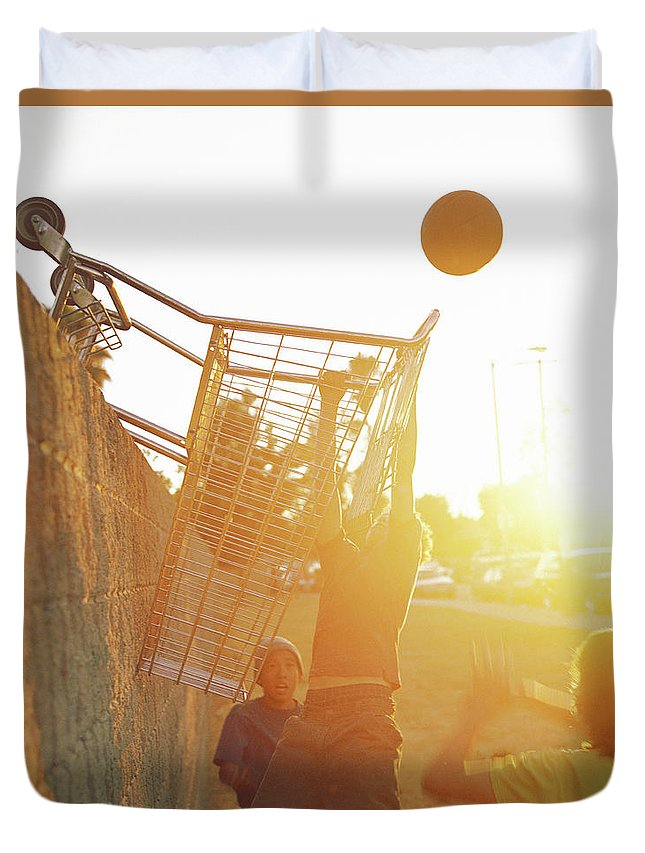 Hanging Duvet Cover featuring the photograph Teenage Boys 13-15 Playing Basketball by Sean Murphy
