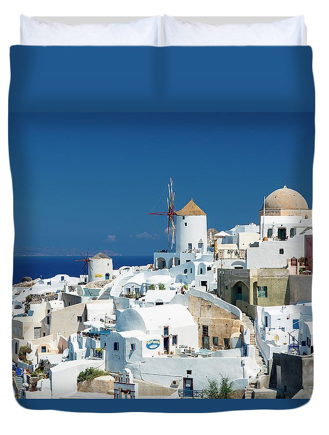 Greek Culture Duvet Cover featuring the photograph The Small Greek Village Of Oia by Sylvain Sonnet