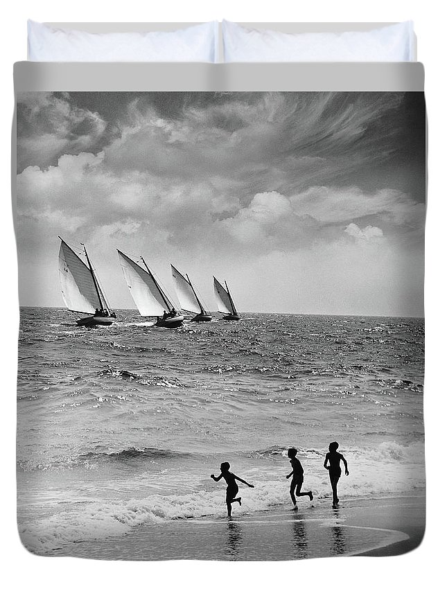 Following Duvet Cover featuring the photograph Three Boys Running Along Beach by Stockbyte