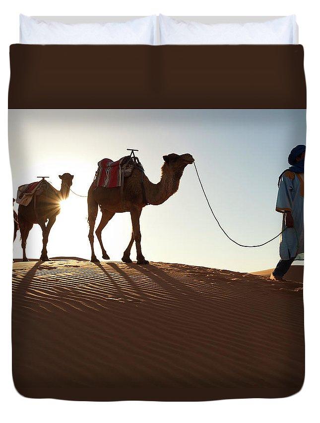 People Duvet Cover featuring the photograph Tuareg Man & Camels, Erg Chebbi, Sahara by Peter Adams