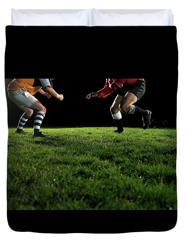 Grass Duvet Cover featuring the photograph Two Opposing Rugby Players, One Holding by Thomas Barwick