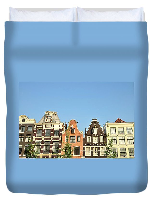 In A Row Duvet Cover featuring the photograph Typical Canal Houses, Amsterdam, The by Gorazdbertalanic