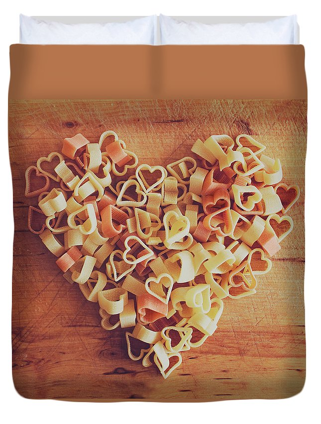 Italian Food Duvet Cover featuring the photograph Uncooked Heart-shaped Pasta by Julia Davila-lampe
