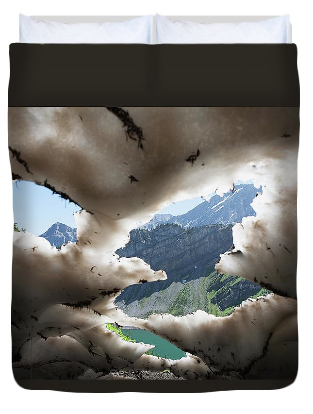 Scenics Duvet Cover featuring the photograph Underneath A Melting Snow Pack With by Michael Interisano / Design Pics