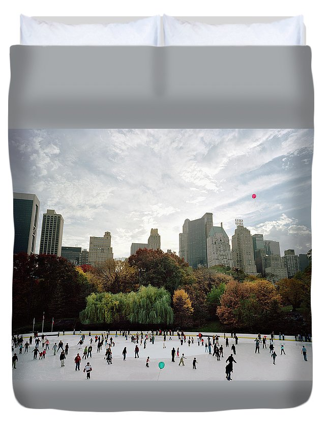 Child Duvet Cover featuring the photograph Usa, New York City, People Ice Skating by Carl Lyttle