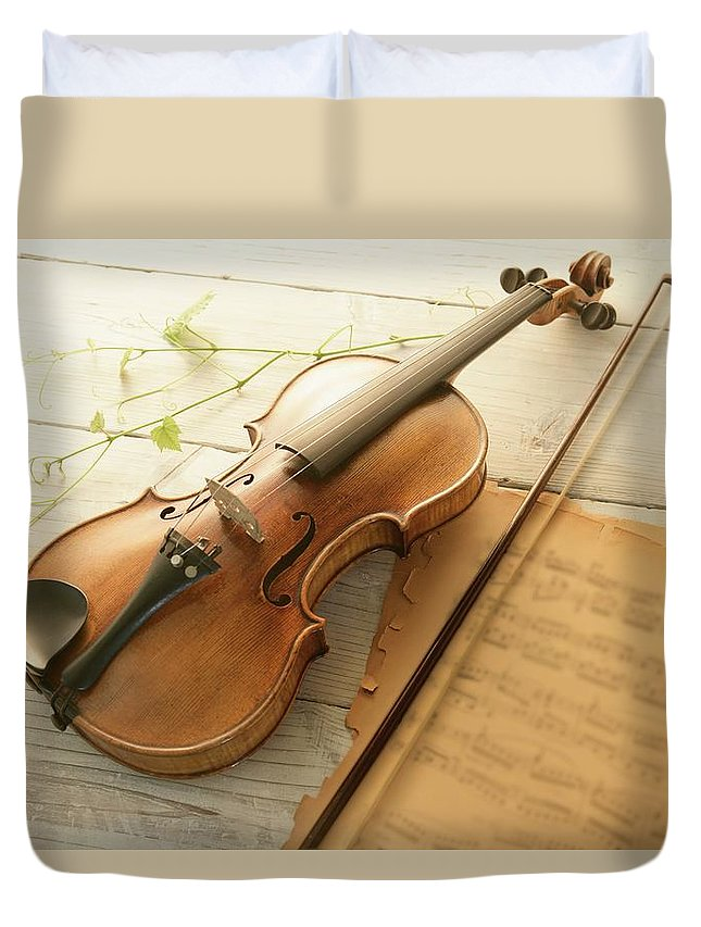 Sheet Music Duvet Cover featuring the photograph Violin And Music Sheet by Image Work/amanaimagesrf