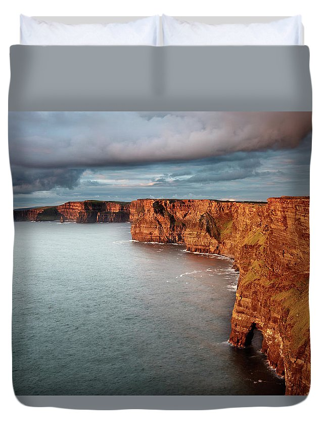 Scenics Duvet Cover featuring the photograph Waves Washing Up On Rocky Cliffs by George Karbus Photography