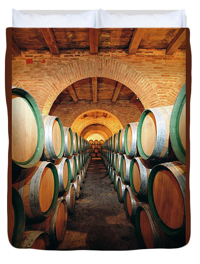 Working Duvet Cover featuring the photograph Wine Barrels In Cellar, Spain by Johner Images