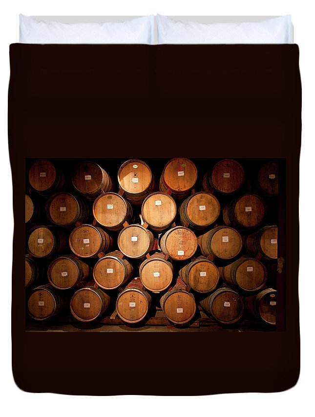 Spot Lit Duvet Cover featuring the photograph Wine Barrels by Ryan Mcginnis