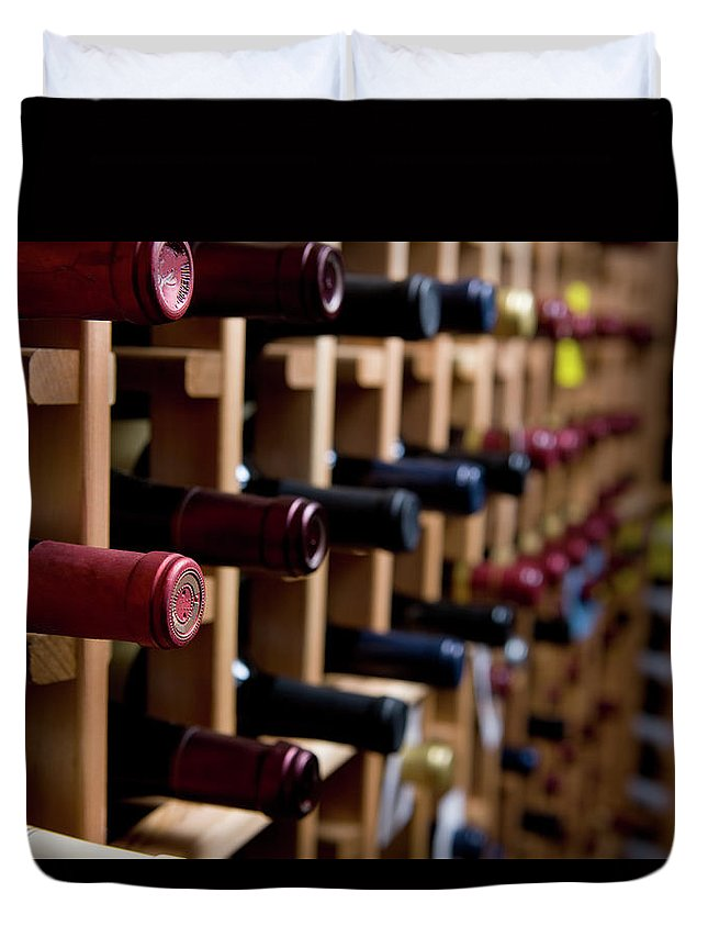 Alcohol Duvet Cover featuring the photograph Wine Bottles In Cellar by Markhatfield