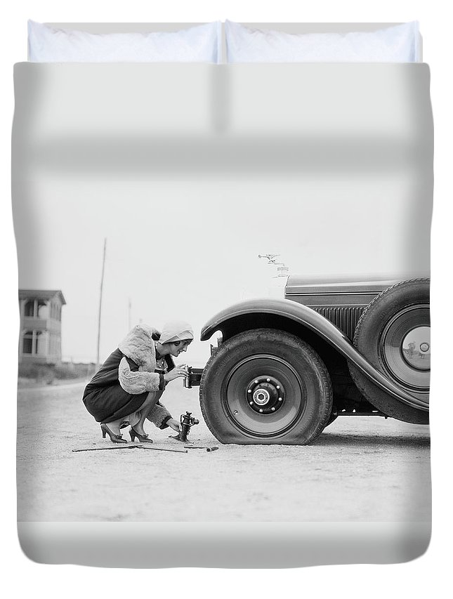 People Duvet Cover featuring the photograph Woman Changing Flat Tire On Car by H. Armstrong Roberts