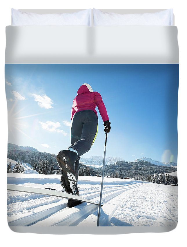 Skiing Duvet Cover featuring the photograph Woman Doing Cross-country Skiing by Tomml