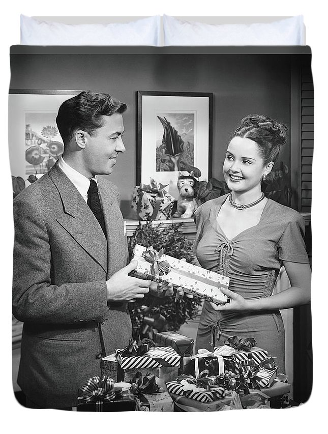 Heterosexual Couple Duvet Cover featuring the photograph Woman Giving Gift To Man, B&w by George Marks