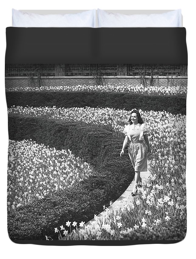 Flowerbed Duvet Cover featuring the photograph Woman Walking On Flowerbed, B&w by George Marks