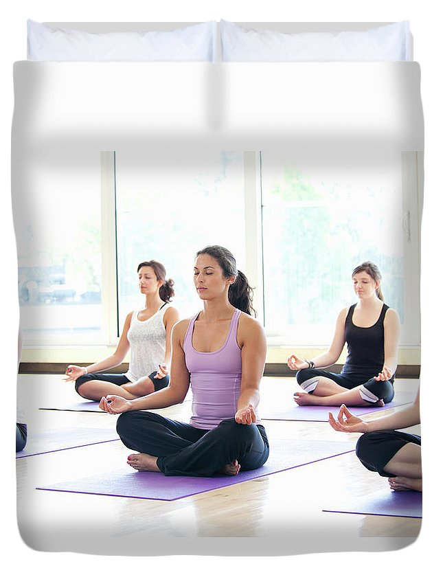Mid Adult Women Duvet Cover featuring the photograph Women Practicing Yoga In A Class by Assembly
